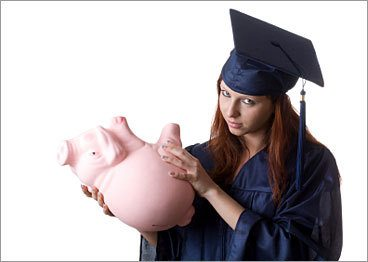 girl shaking a piggy bank for college savings