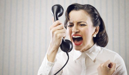 Angry Business Woman shouting into telephone